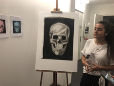 student-presenting-skull-charcoal-drawing-e5-art-portfolio